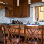 kitchen with wooden accents and tile backsplash