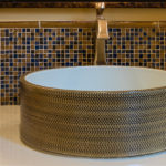 bathroom sink with tile backsplash